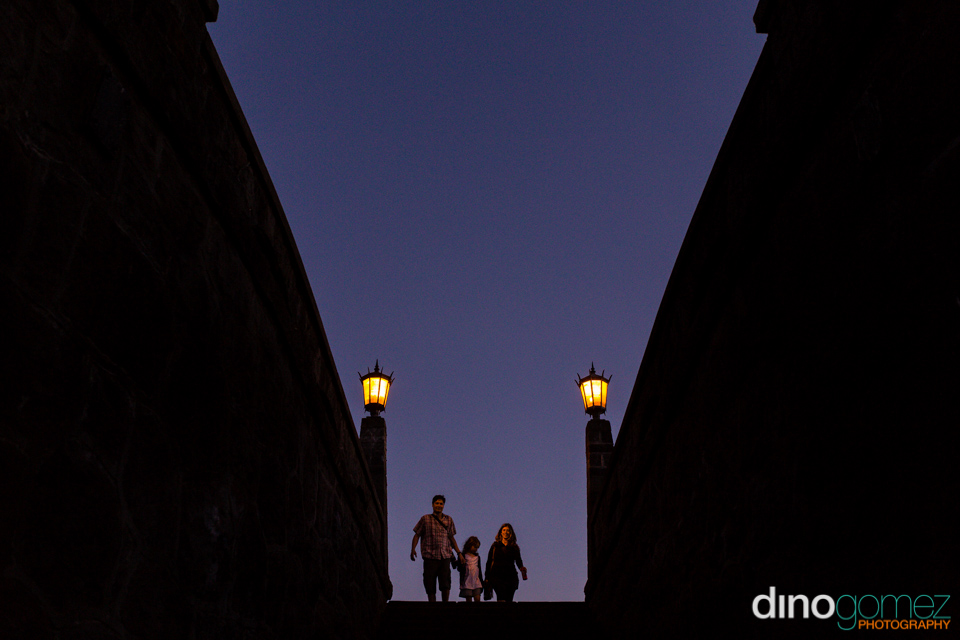 Family at the top of a stairs in Portland by destination wedding photographer Dino Gomez
