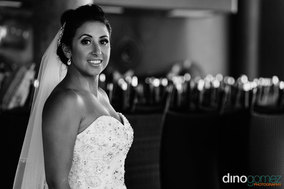 A true creative portrait of the bride in black and white at her Australian destination Wedding in Los Cabos Mexico