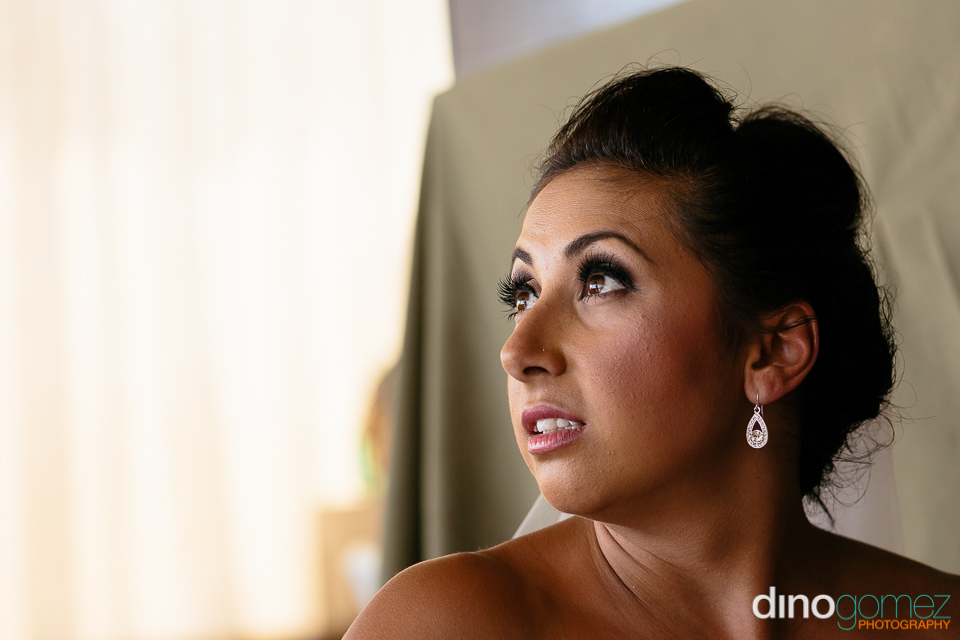 Closeup face shot of the bride at her Australian destination wedding in Los Cabos Mexico