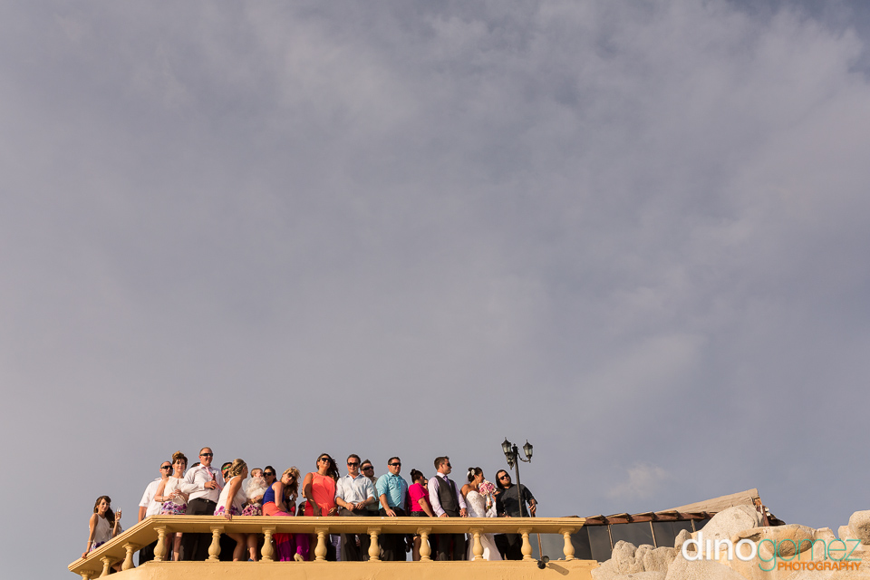 Destination wedding guests standing on a balcony in Los Cabos Mexico