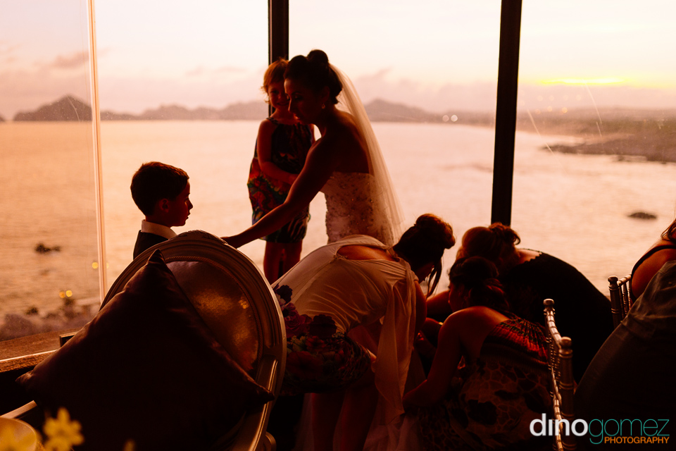 Cute shot of the bride getting ready with help by the talented photographer Dino Gomez
