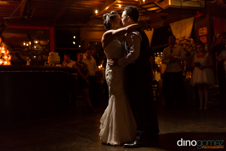 A Great Wedding Shot Of The Newlyweds Kissing Inside As They Dance By Photographer Dino Gomez
