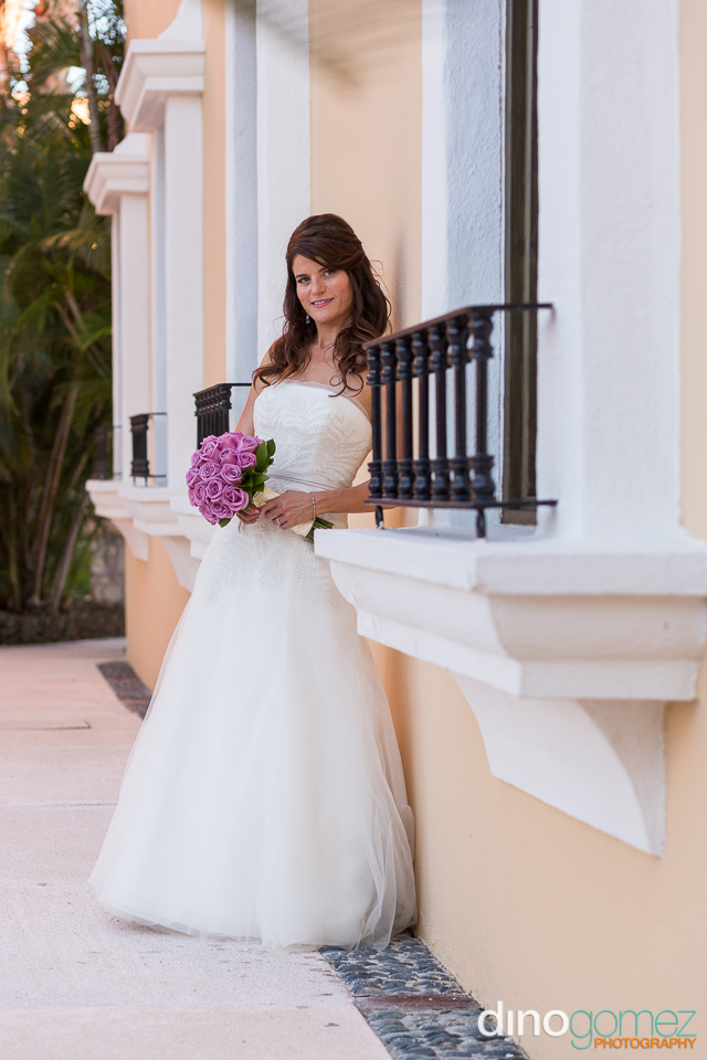 A Beautiful Bride Posing Against The Wall After Her Jewish Destination Wedding In Mexico