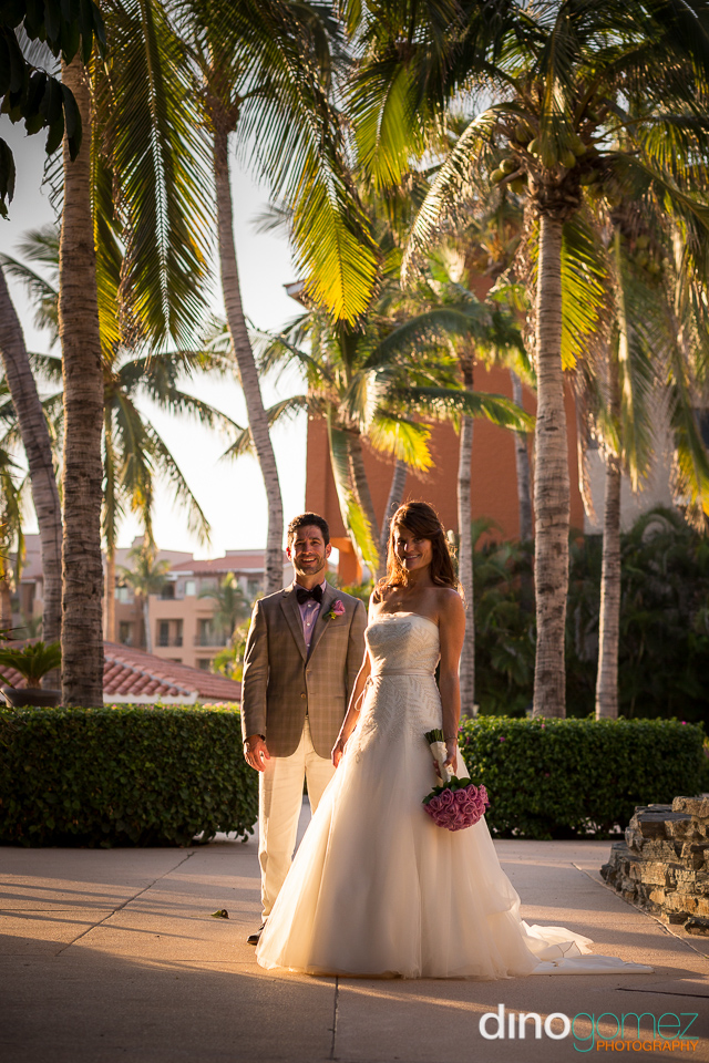 Gorgeous Bride Holding A Lilac Bouquet While Standing Next To Her Husband In Mexico