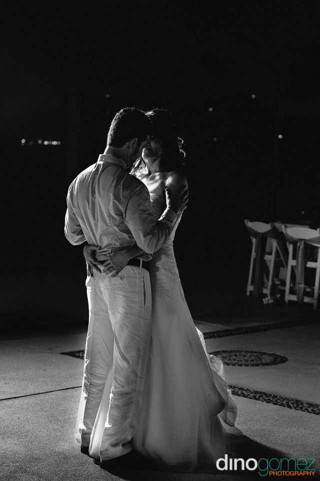 Destination Wedding Couple Dancing In Black And White By Wedding Photographer Dino Gomez