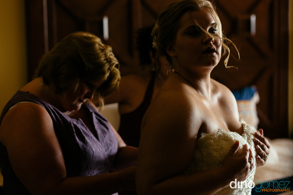 Lovely shot of the shot of the bride getting ready for her big day by desination wedding photographer Dino Gomez