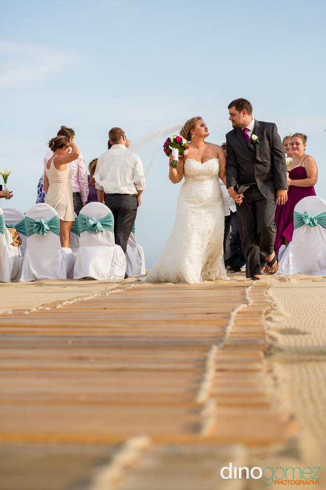 Bride and groom walking down the aisle as husband and wife in Los Cabos Mexico