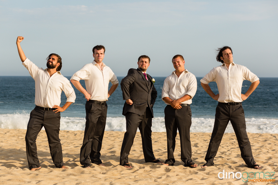 The funny groom and groomsmen posing on the beach in Mexico