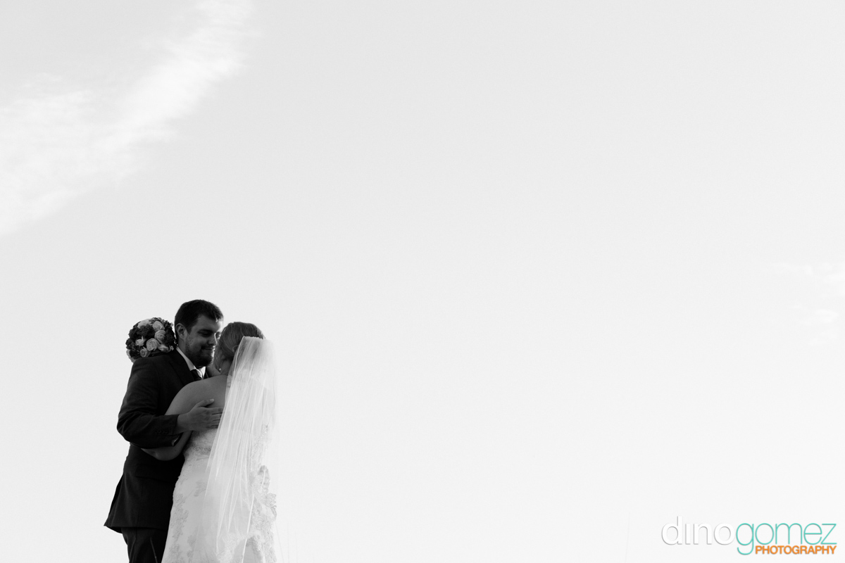 Gorgeous black and white wedding shot of the bride and groom by destination wedding photographer Dino Gomez