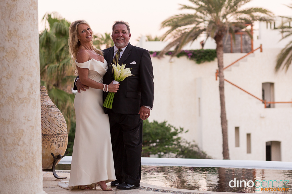 Happy wedding bride and groom posing for wedding photographer in Cabo Dino Gomez
