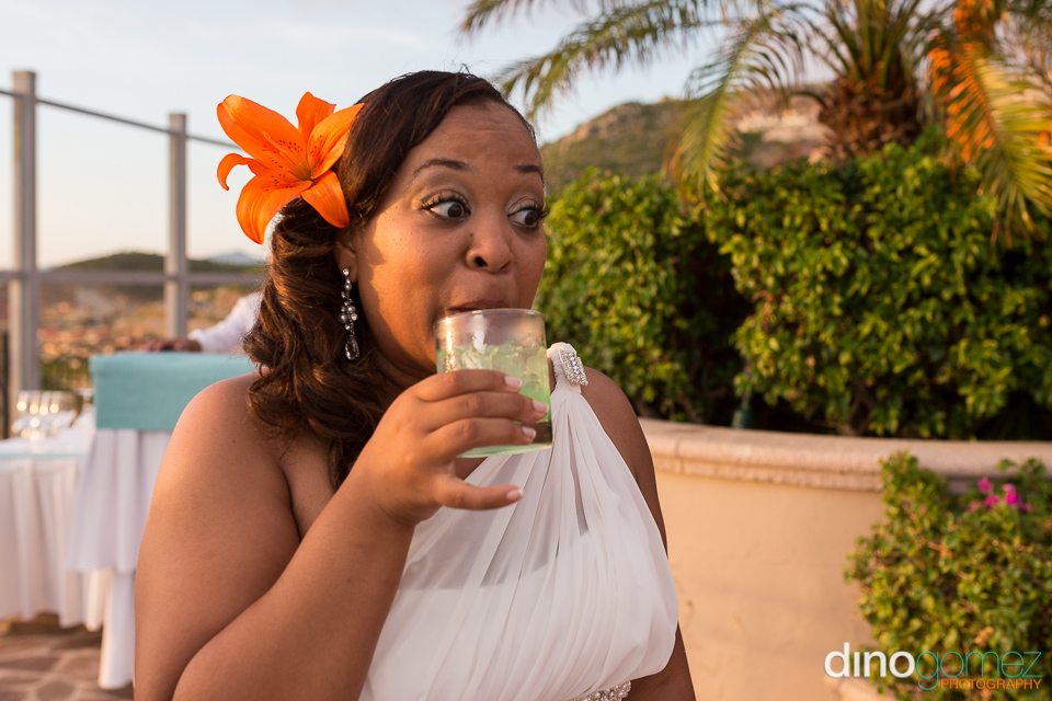 Bride enjoying a green cocktail