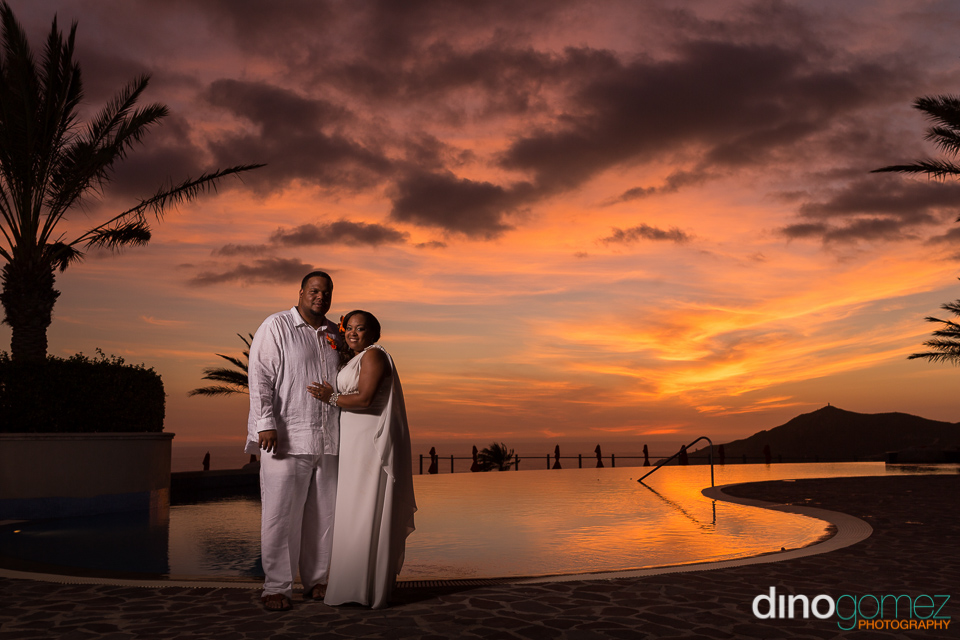 Beautiful shot of the newly wed bride and groom as the sun sets