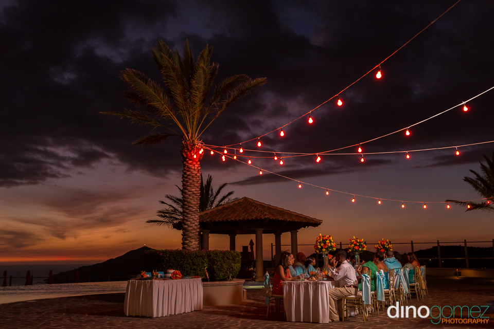 Wedding guests seated at a table in Cabos