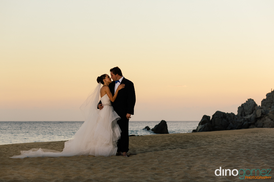 A snap of the wedding couple getting steamy on the beach courtesy of photographer in Riviera Maya Dino Gomez