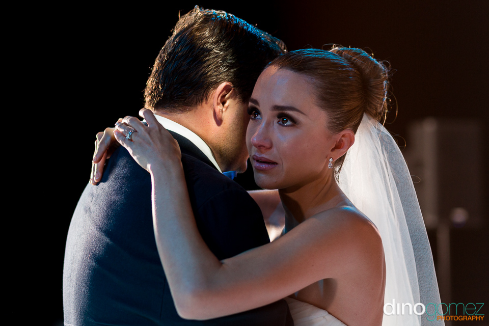 An emotional bride dancing with her new husband in Mexico
