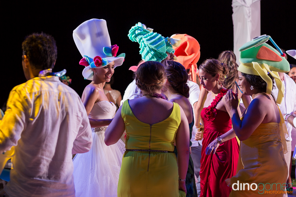 A shot of the bride and her guests in huge hats at her destination wedding in Mexico