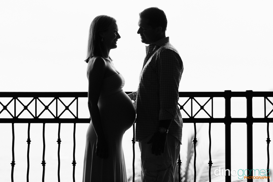 Maternity shot of the parents to be facing each other in Los Cabos