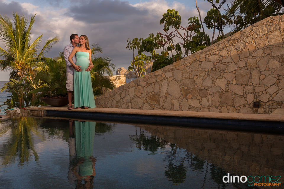 Maternity shoot with husband beside the pool in Los Cabos Mexicoo