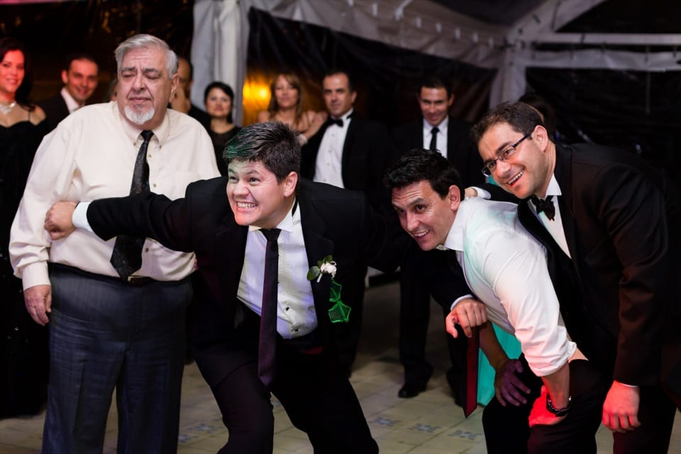 Wedding guests waiting for the garter toss in Bogota Colombia