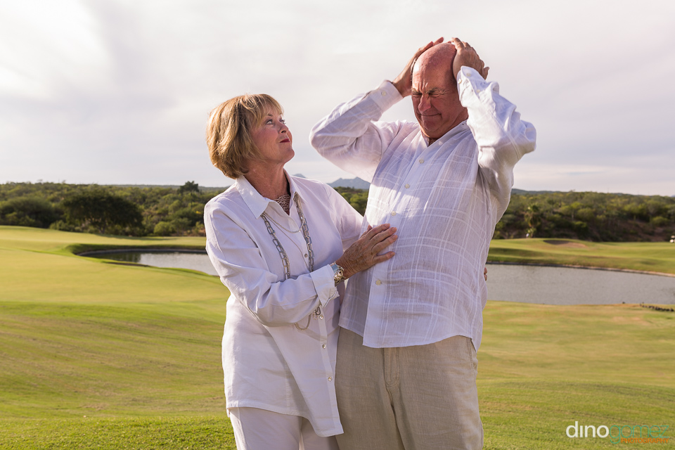 Husband and wife on the golf course in Cabo Mexico