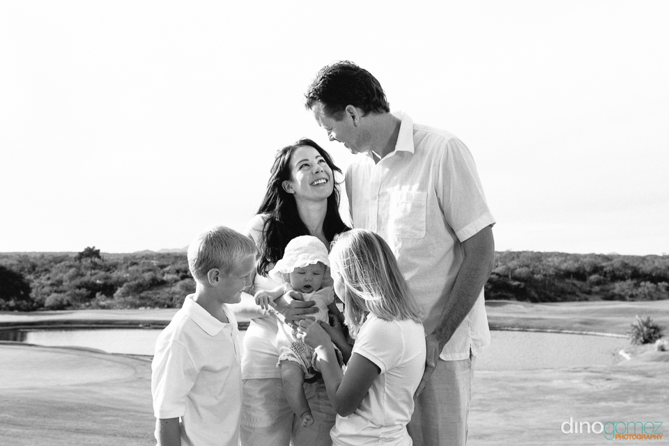 Black and white family photo of mother and father and their three children