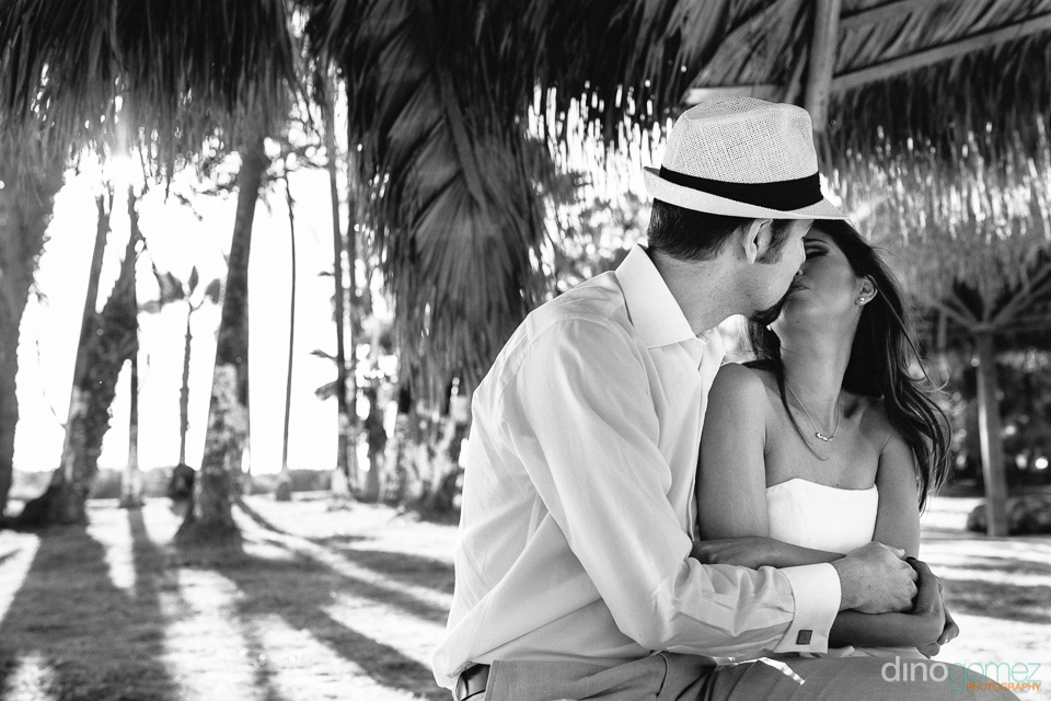 Closeup portrait of couple kissing in black and white in Mexico