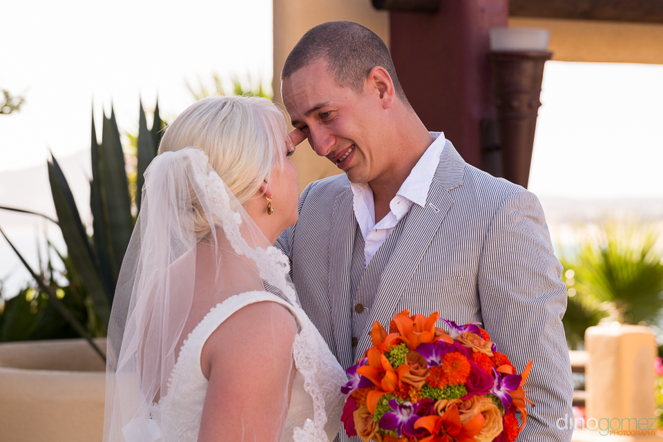 Groom looking lovingly at his beautiful bride at their destination wedding in Mexico
