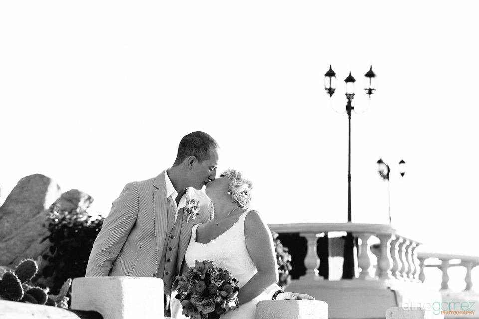 Black and white shot of the destination wedding couple kissing