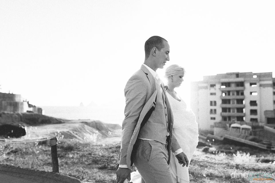 Side view of the newlyweds walking together courtesy of destination wedding photographer Dino Gomez