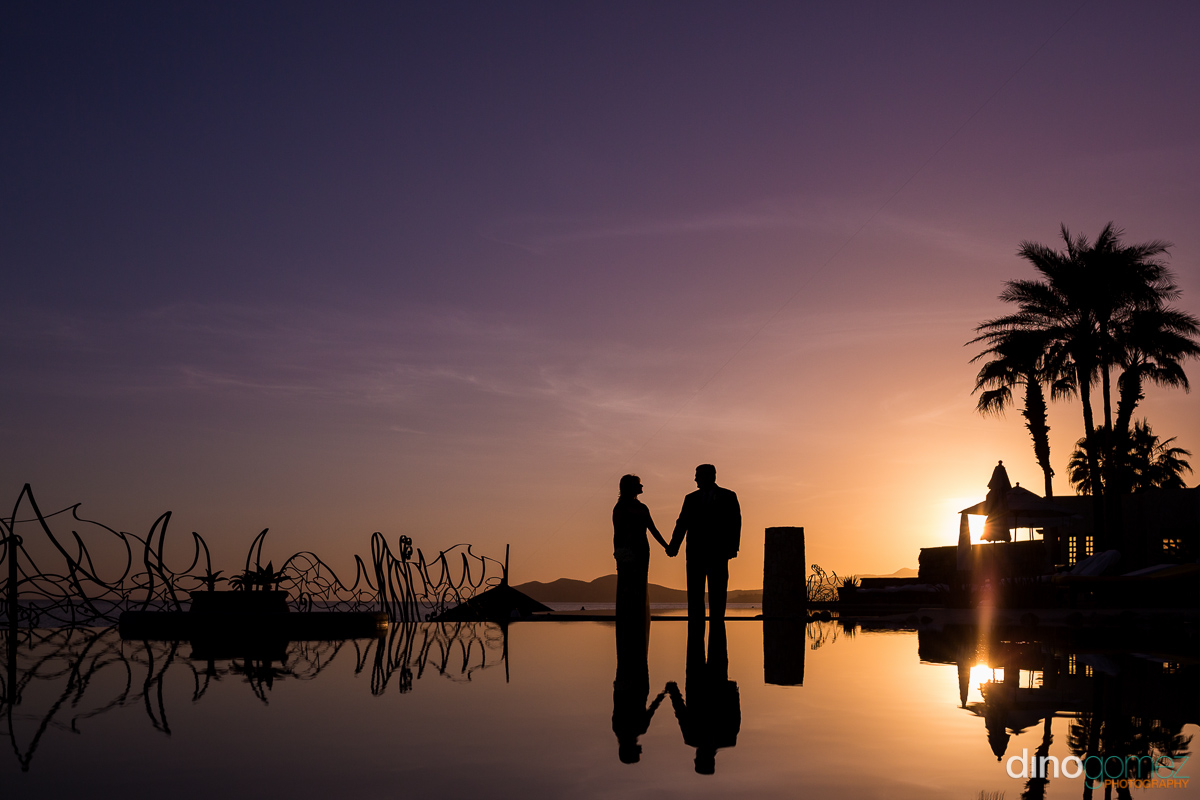 Romantic sunset silhouette after renewing their wedding vows