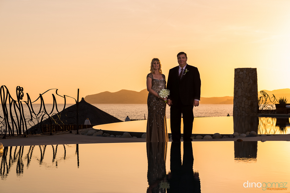Romantic shot of husband and wife with sun flare at a villa in Mexico