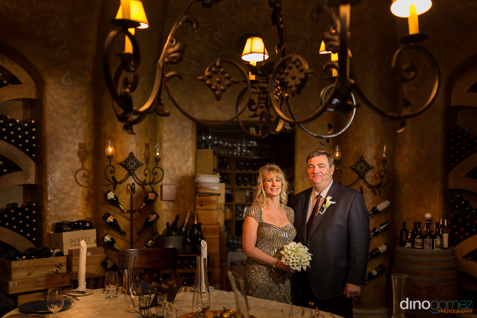 Happy couple on their wedding anniversary in the wine cellar
