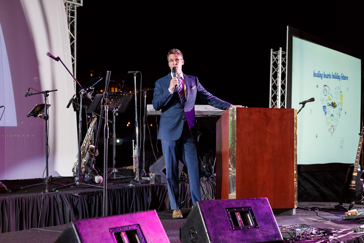 A Snap Shot Of A Well Dressed Man Speaking At An Event In Mexico By Photographer In Cancun Dino Gomez