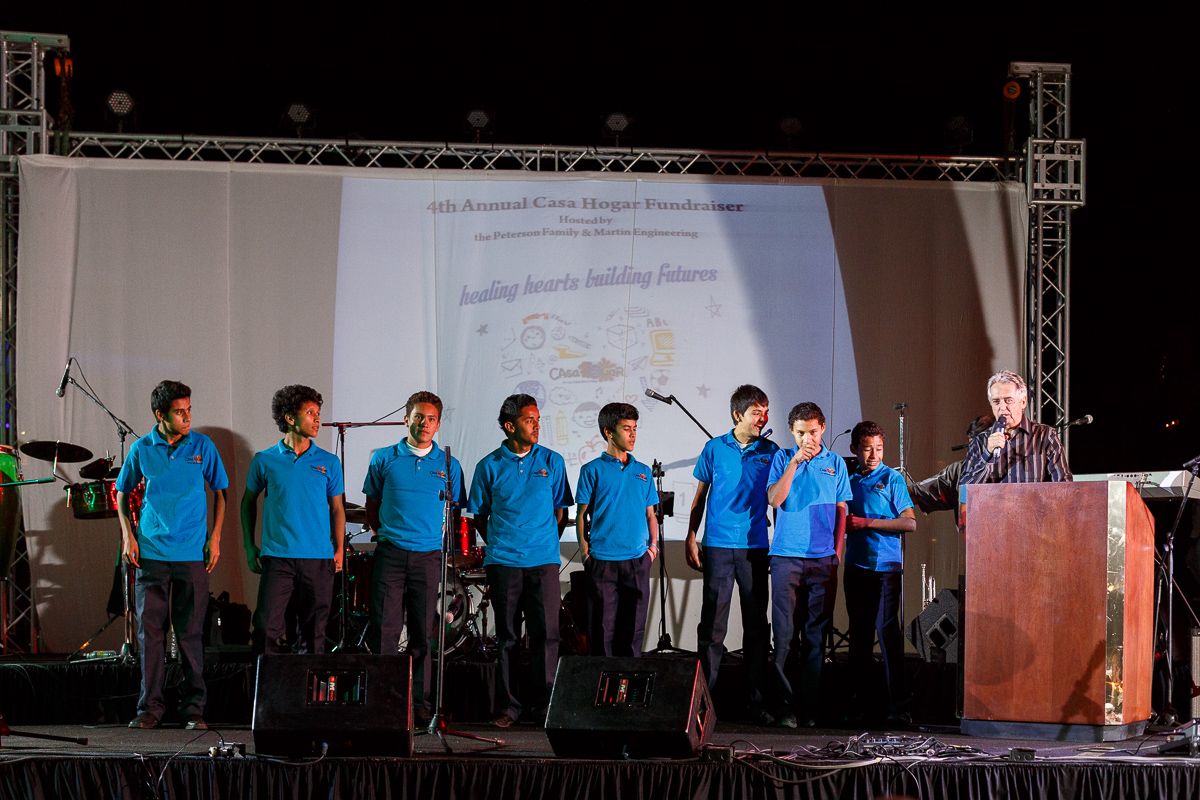 A shot of a group of young men on stage at a fundraiser in Mexico