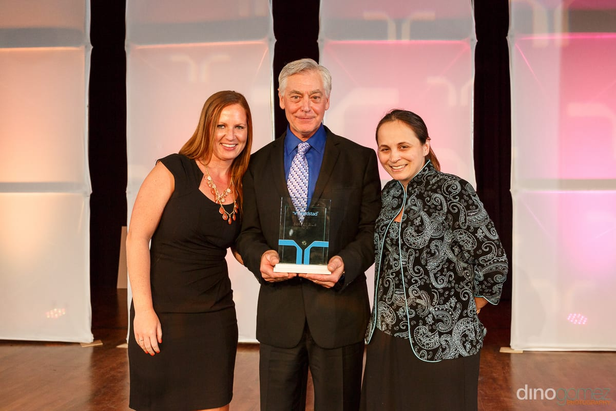 Three people accepting an award at the Randstad Cabo 2014 - Secrets Pue