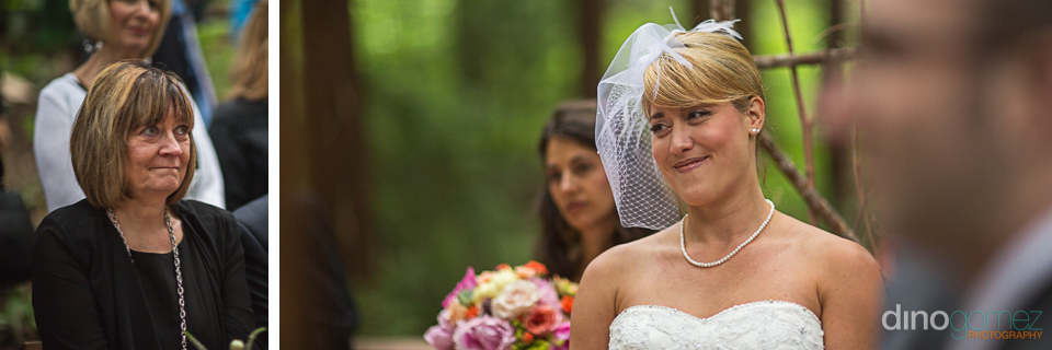 Cute shot of the smiling bride looking at her mother during the wedding ceremony by wedding photographer Dino Gomez