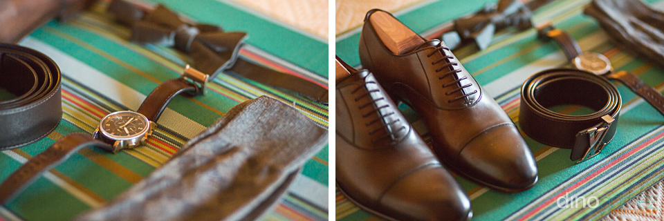 The groom's wedding attire laid out on a green striped fabric