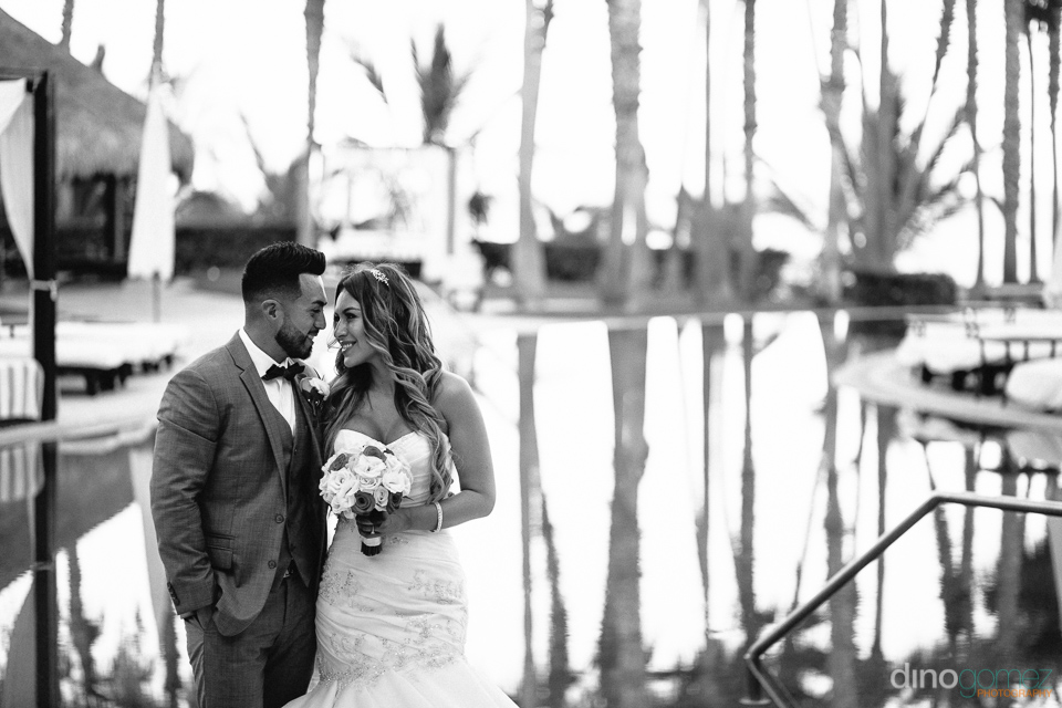 bride and groom looking into each other's eyes