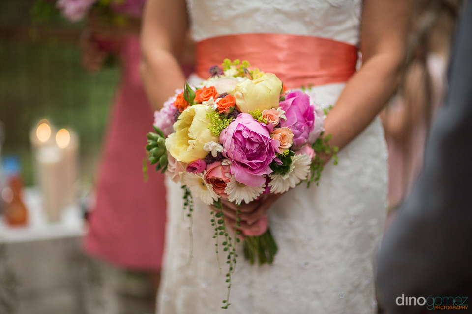 bride holding beautiful flowers at ceremony