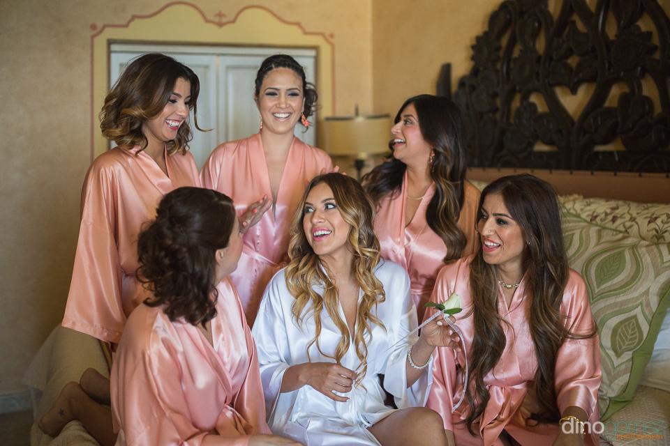 bride laughing with bridesmaid at the hilton los cabos