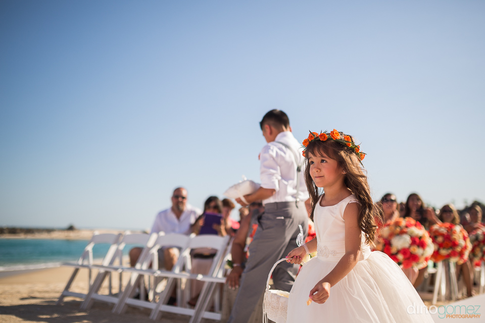 cute flower girl at wedding ceremony