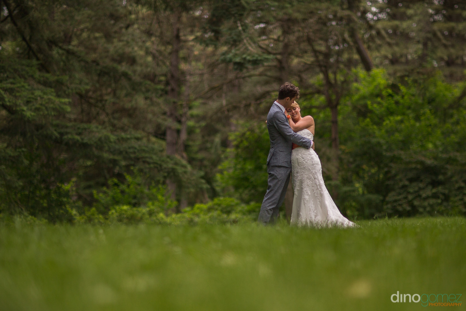cute photo of bride and groom hugging at the hoyt arboretum port