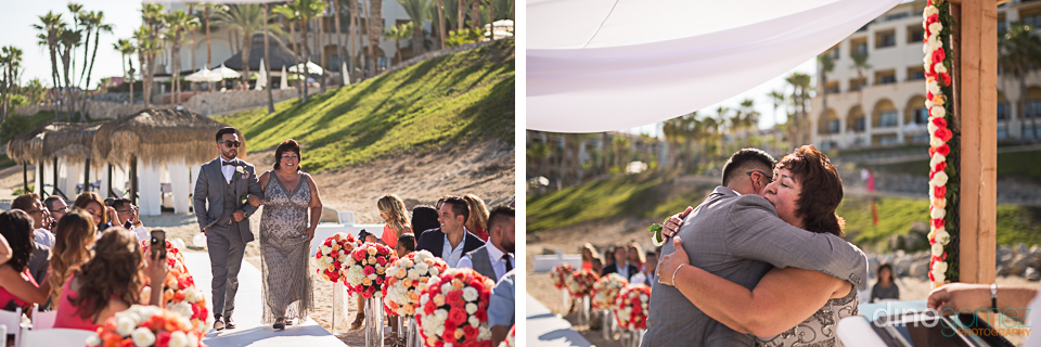 Groom walking down the aisle with his mom before the wedding