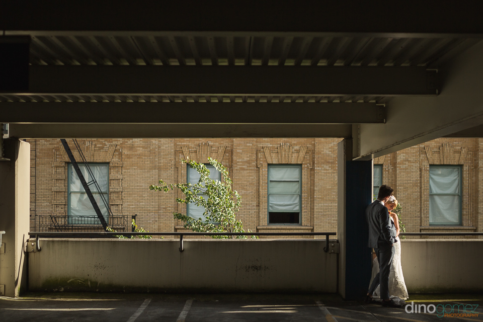 photo of bride and groom at a parking lot in Portland