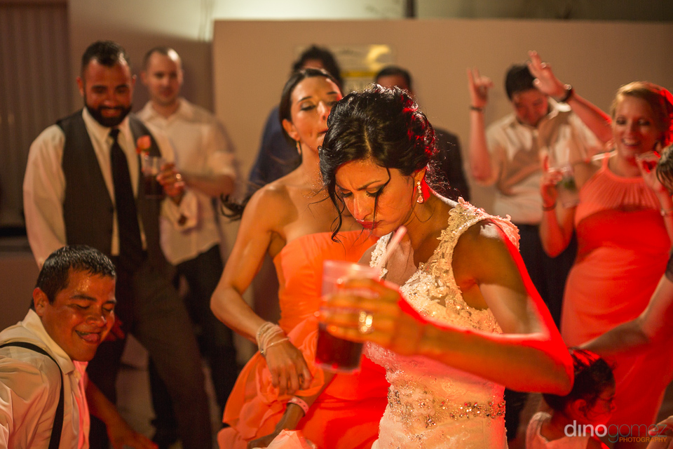 Photo of bride dancing with other guests