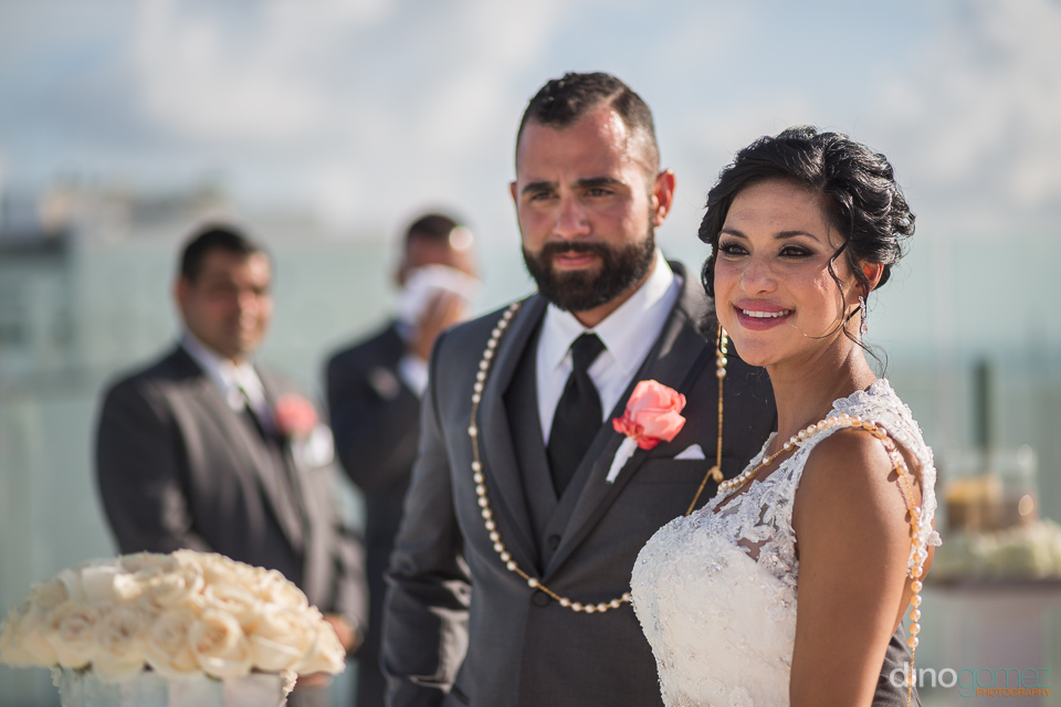 beautiful couple at their wedding ceremony in cancun - riviera m