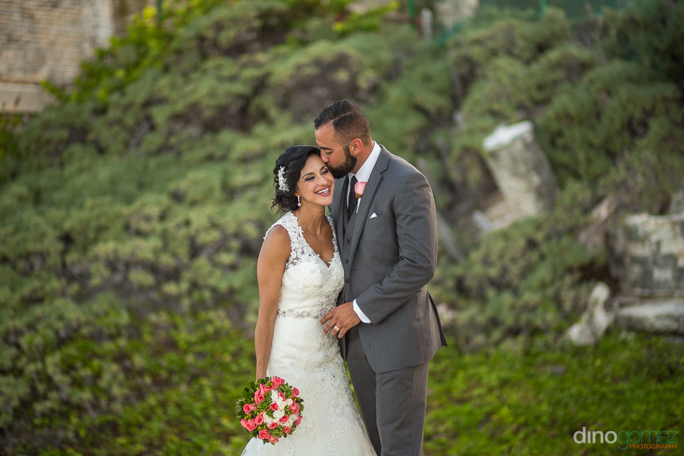 beautiful photo of bride and groom with a green background in ca