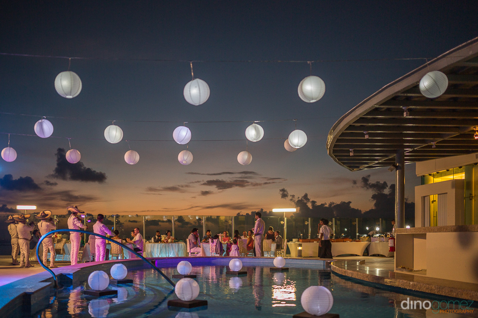 beautiful suncet wedding reception on the rooftop of the beach p