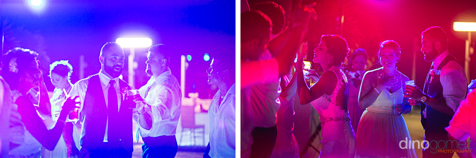 Bride and groom dancing under heavy LED lighting at the reception