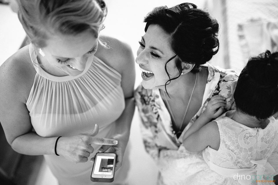 bride laughing out loud with maid of honour